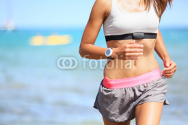 Naklejki Runner woman with heart rate monitor running