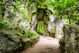 Fototapety Scenic stone walkway leading to gate in rocks