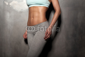 Obrazy i plakaty Fitness female woman with muscular body, do her workout, abs, ab