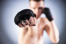 Fototapety Boxing. Fighter's fist close-up