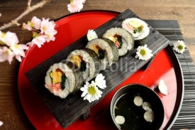 Sushi roll on Japanese red tray