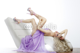 Obrazy i plakaty Elegant sensual young woman in dress