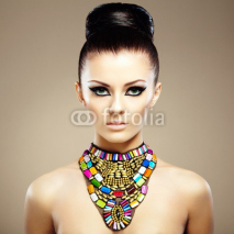Obrazy i plakaty Portrait of young beautiful woman with jewelry