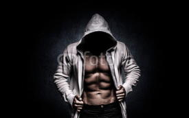 Fototapety strong athletic man on black background