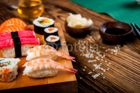 Naklejki Wonderful sushi set, oriental theme on the old wooden table