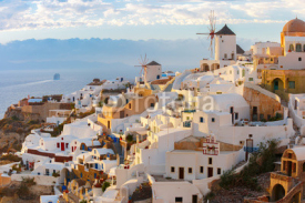 Fototapety Picturesque famous view, Old Town of Oia or Ia on the island Santorini, white houses and windmills at sunset, Greece