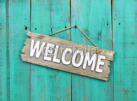 Naklejki Welcome sign hanging on rustic background