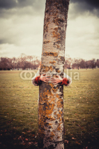 Fototapety Woman hugging a tree