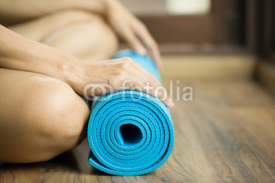 Fototapety Young woman holding a yoga mat