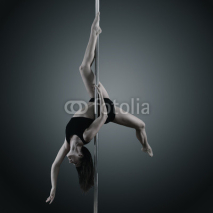 Naklejki pole dancer, young woman dancing on pylon, toned and noise added
