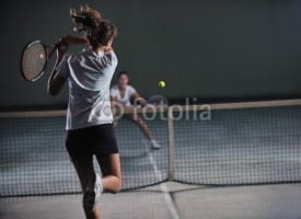 Fototapety young girls playing tennis game indoor