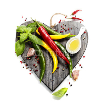Fototapety Fresh vegetables on heart shaped cutting board