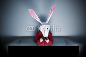 Obrazy i plakaty Rabbit gamer on the sofa