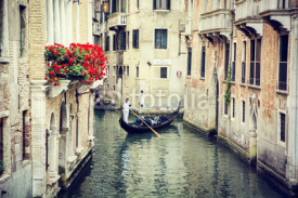 Canal in Venice, Italy with gondola