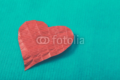 Red heart, isolated on green background