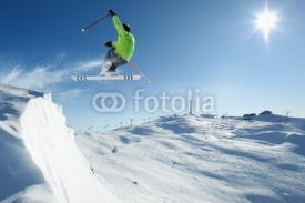 Naklejki Jumping Skier in alpine mountains