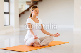 Fototapety young woman doing yoga exercise