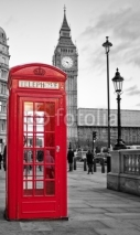 Naklejki Red phone booth in London with the Big Ben in black and white