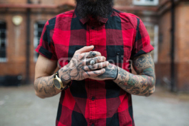 Obrazy i plakaty Hands close up of young tattooed man portrait in Shoreditch. London.