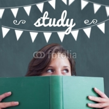 Fototapety Study against student holding book