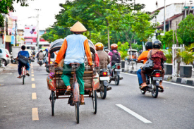 Naklejki View of Yogyakarta with its typical hundreds of motorbikes on th