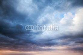 Obrazy i plakaty Dark blue stormy cloudy sky. Natural photo background