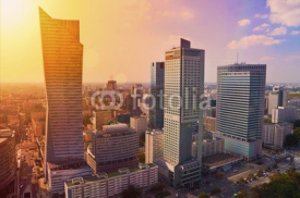 Obrazy i plakaty Warsaw downtown - aerial photo of modern skyscrapers at sunset