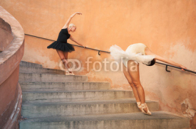 Naklejki Young beautiful ballerinas dancing on the stairs.