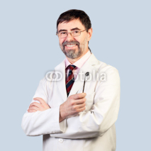 Naklejki Portrait of happy middle-aged dentist on a pale background, wear