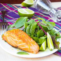 Fototapety Grilled fillet of red salmon and salad with green leaves of lett