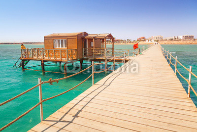 Wooden pier with change room house on Red Sea in Egypt