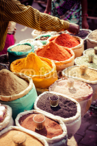 Fototapety Traditional spices and dry fruits in local bazaar in India.