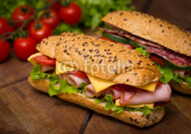 Naklejki Sandwiches on the wooden table