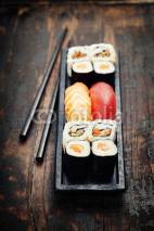 Fototapety sushi with chopsticks