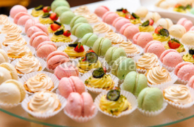 Naklejki Tray with delicious cakes and macaroon