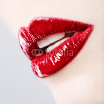 Fototapety Beautiful female with red shiny lips close up