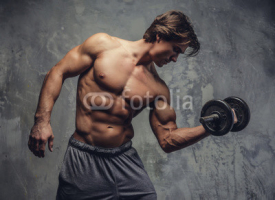 Obrazy i plakaty Shirtless muscular man doing biceps workout.
