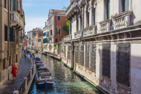 Obrazy i plakaty Narrow canal among old colorful brick houses in Venice