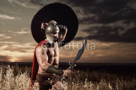 Spartan warrior going forward in attack with sword.