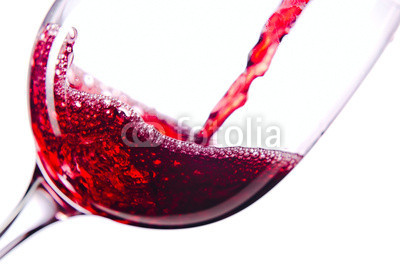 Naklejki Red wine on white background